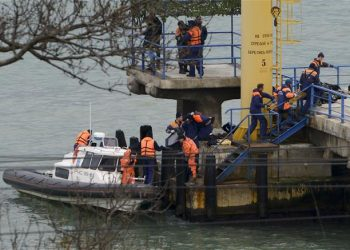 Russian rescue workers carry a body from the wreckage of the crashed plane, at a pier just outside Sochi, Russia, Sunday, Dec. 25, 2016. Russian ships, helicopters and drones are searching for bodies after a plane carrying 92 people crashed into the Black Sea. The plane was taking the Alexandrov Ensemble,...  (Associated Press)