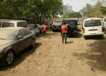 operatives of the EFCC inside the warehouse