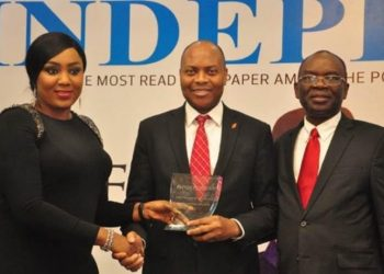 l-r: Director, Independent Newspapers, Adaobi Nwakuche, presenting the award of the Most Innovative Bank won by UBA Plc to the Divisional Head, Digital and Consumer Banking, United Bank for Africa( UBA) Plc, Mr Yinka Adedeji while Managing Director, Independent Newspapers, Mr. Ted Iwere looks on, at the Independent Newspapers Awards, held in Lagos at weekend