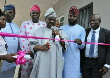 Governor Abiola Ajimobi of Oyo state flanks by Commissioner for Education professor Joseph Olowofela and Hon Saheed Fjabi  during the commissioning of the ICT centre donated to Oyo Sate College of  Science and Technology in Ibadan