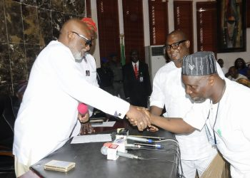 Ondo State governor, Mr Oluwarotimi Akeredolu, SAN, receiving the two lawmakers of the state House of Assembly, Hon Olugbenga Araoyinbo (Majority Leader) and Hon Malachi Comer, to the APC fold, yesterday, at Governor's Office, Akure, shortly after their defection from the PDP