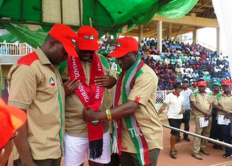 Governor Ayo Fayose being decorated by the leaders of the Labour Union