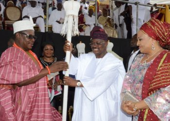 L-R: Ekerin Olubadan of Ibadanland, Oba Abiodun Kola-Daisi; Oyo State Governor, Senator Abiola Ajimobi; and his wife, Florence, during the presentation of staff of office and certificates to the high chiefs and baales who were promoted as obas by the governor, at Mapo Hall, Ibadan... on Sunday. Photo: Governor's Office