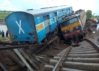 Two Indian passenger trains lay next to each other following a derailment after they were hit by flash floods on a bridge outside the town of Harda in Madhya Pradesh state on August 5, 2015. Two passenger trains derailed after being hit by flash floods on a bridge in central India, killing at least 27 people in the latest deadly accident on the nation's crumbling rail network. AFP PHOTO        (Photo credit should read STR/AFP/Getty Images)