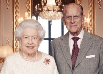 Britain's Queen Elizabeth and Prince Philip pose for a photograph in the White Drawing Room at Windsor Castle, England in this handout photo issued Nov. 18, 2017, in celebration of their platinum wedding anniversary Nov. 20, 2017.