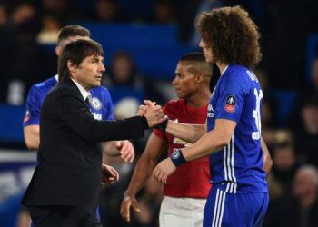 Chelsea's Italian head coach Antonio Conte (L) shakes hands with Chelsea's Brazilian defender David Luiz on the pitch after the English FA Cup quarter final football match between Chelsea and Manchester United at Stamford Bridge in London on March 13, 2017.         (Photo  GLYN KIRK/AFP/Getty Images)