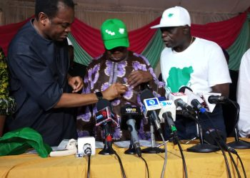 Former Governor of Cross River state Donald Duke, fixing party crest on Chief Olusegun Obasanjo's logo while Former Governor of Osun state  Prince Olagunsoye Oyinlola watches