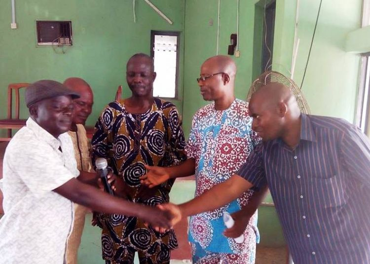 NUJ chairman, Comrade Adewumi Faniran and Secretary Bola Ogunlayi congratulating members of ethics and disciplinary committee