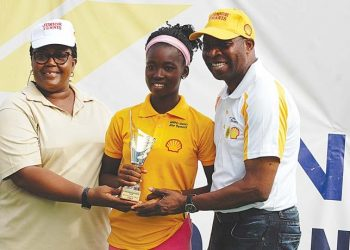 Winner, Girls 16 & MOP, Omolayo Bamidele (middle) receiving from her trophy from Ogunjoye (left) and Ikhanna Mborah of the Sports Ministry at the end of the SNEPco Junior Tennis Championship in Lagos…at the weekend.