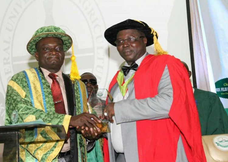 Professor Salako, Vice Chancellor FUNAB  Presenting Award to  Prof Olowofela after the 56th Inaugural lecture  of FUNNAB