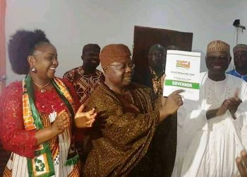 Senator Omisore displaying the form