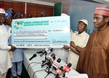 NCAN  leaders presenting the cheque to Chairman of the All Progressives Congress (APC), Comrade Adams Oshiomhole, in Abuja.
