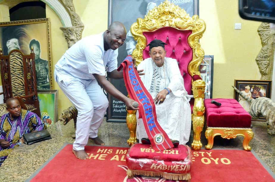 TAMPAN national president, Mr. Bolaji Amusan, left, presents the Alaafin of Oyo His Imperial Majesty Oba Lamidi Adeyemi 111 with the insignia of the honourary title of 'Life Royal Grand Patron of TAMPAN Worldwide', in his palace in Oyo town.