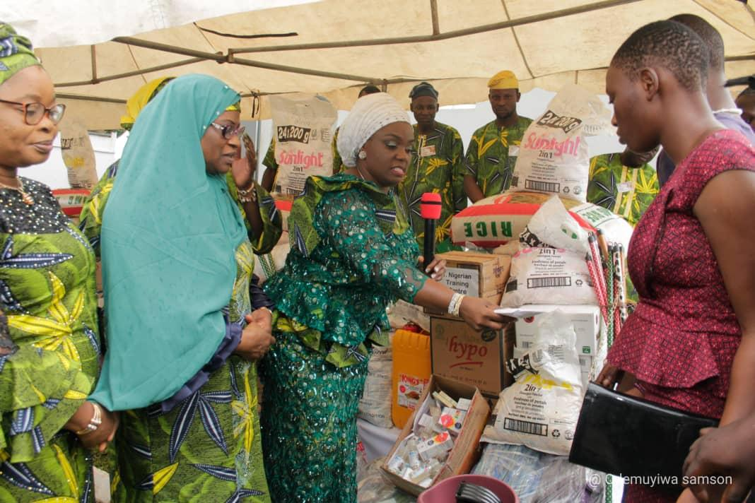 Photo Shows the wife of Oyo State Governor, Engr. (Mrs.) Tamunominini Makinde flanked by the right by the Commissioner for Women Affairs and Social Inclusion, Alhaja Faosat Sanni and Oyo State Head of Service, Alhaja Ololade Agboola as the First Lady hands over cash gift and other materials to one of the children from the Homes for Special Children at her Agodi office in Ibadan
