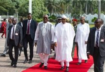 be patient president buhari tells neighoruing country on
