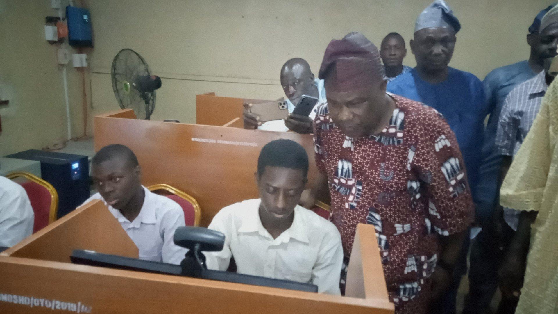 Senator Buhari inspecting a student on computer at Anglican Grammar School Ogbomoso