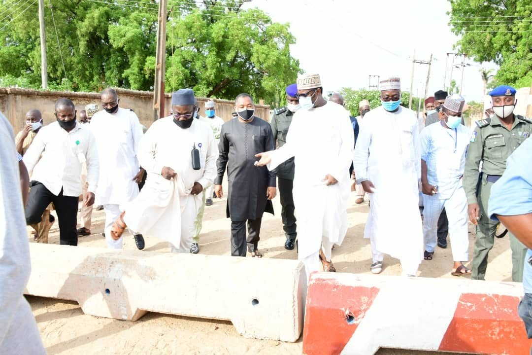 Governor Abubakar Sani Bello and his aides inspecting ongoing  construction work in the state