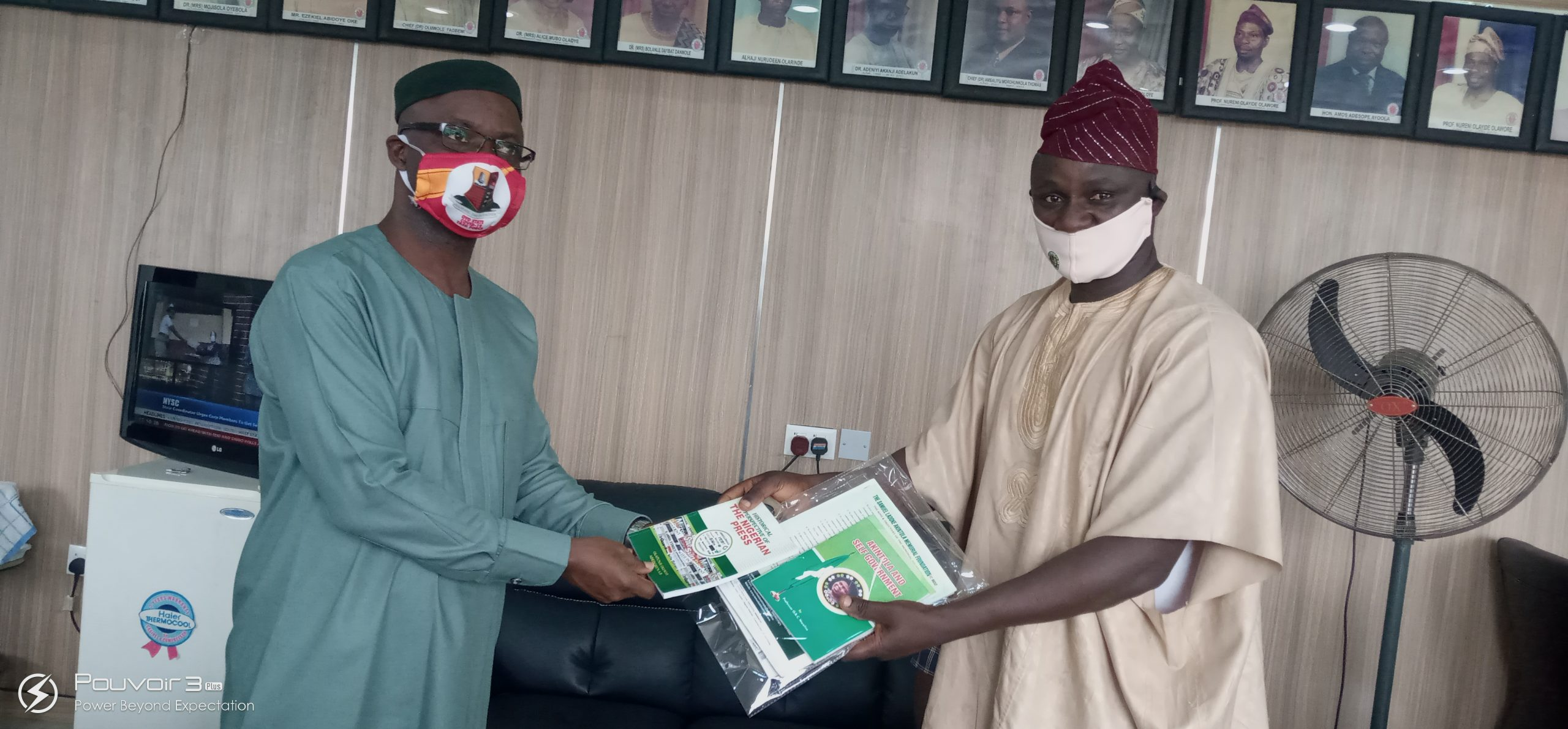 Barr Sunkami Olaleye, Oyo state commissioner for Education Science and Technology   Receiving souvenirs presented by Mr Yemi Adedokun cordinator Ladoke Akintola Foundation