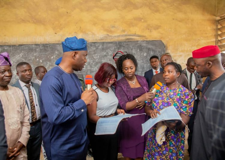 Oyo state Governor Engn Seyi Makinde, and Commissioner for Education Barrister Sunkanmi Olaleye  with some some teachers during a visit to schools in Ibadan