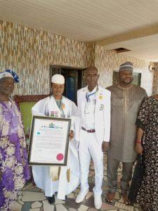 "Regent Oyebola being bestowed with the ""Golden Fame of 21st Century Award "" by UNESCO Laureate Professor, Aremu"