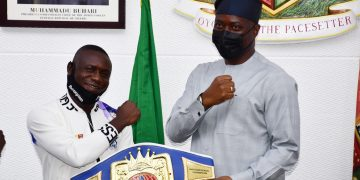 "Oyo State Governor, Engr Seyi Makinde (right) and World Boxing Federation's Super Featherweight Champion, Ridwan  Oyekola ""Scorpion"" (middle) from Oyo State, during the presentation of his Belt to the Governor, why Co-Chairman and President, Nigeria Boxing Board of Control, Dr Rafiu Ladopo look-on at Governor's Office, Secretariat, Ibadan. PHOTO: Oyo State Government."